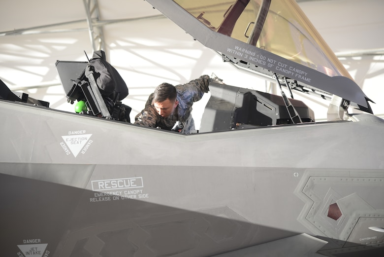 Airman 1st Class Dakota Smith, Assistant Dedicated Crew Chief, 31st Test and Evaluation Squadron, prepares an F-35 Lightning II for take off from Edwards Air Force Base, California, for the final time, Oct. 7. The 31st TES recently completed its initial operational test and evaluation mission and six F-35s were reassigned to the 422nd Test and Evaluation Squadron at Nellis Air Force Base, Nevada. (U.S. Air Force photo by Giancarlo Casem)