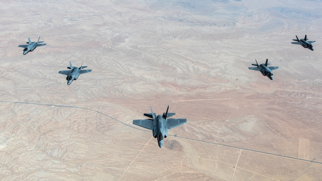 A formation flight of F-35 Lightning IIs over Edwards Air Force Base, California. The 31st Test and Evaluation Squadron recently completed its initial operational test and evaluation mission and six F-35s were reassigned to the 422nd Test and Evaluation Squadron at Nellis Air Force Base, Nevada. (Photo courtesy of Darin Russell, Lockheed Martin)