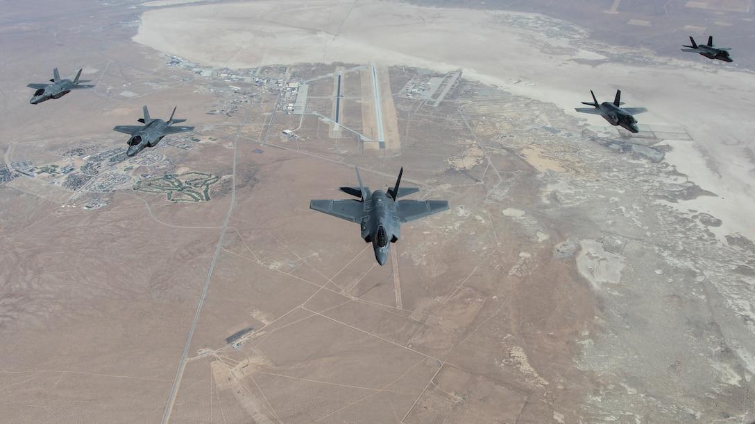 A formation flight of F-35 Lightning IIs over Edwards Air Force Base, California. The 31st Test and Evaluation Squadron recently completed its initial operational test and evaluation mission and six F-35s were reassigned to the 422nd Test and Evaluation Squadron at Nellis Air Force Base, Nevada. Included in the formation are two F-35As, two F-35Bs, and one F-35C. (Photo courtesy of Darin Russell, Lockheed Martin)
