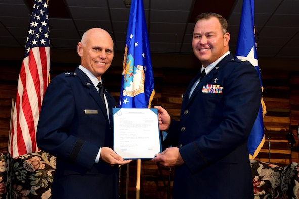 Brig. Gen. Richard Kemble, 94th Airlift commander, left, poses for a photo with Ch. Maj. Stacey Hanson during a promotion ceremony at Hanson's church in Bremen, Georgia on Oct. 20, 2019. Hanson was promoted to lieutenant colonel. (U.S. Air Force photo/Tech. Sgt. Andrew Park)