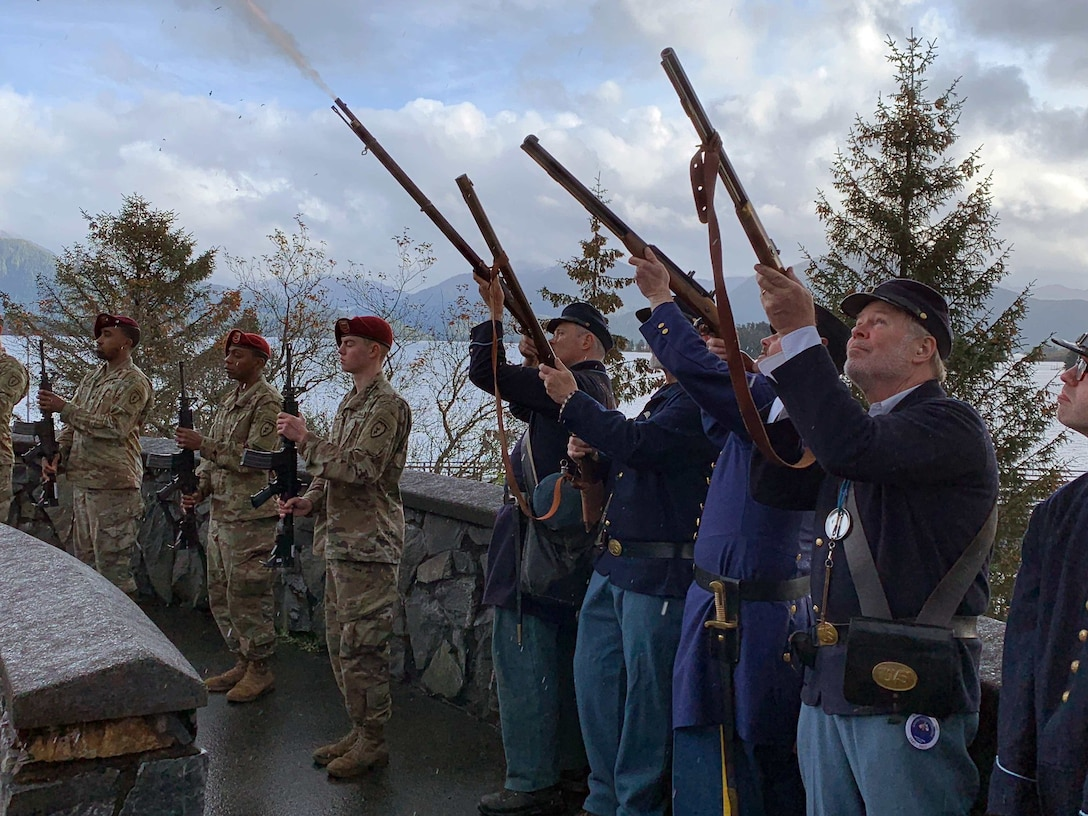 U.S. Army Alaska Soldiers with 725th Brigade Support Battalion, 4th Brigade Combat Team (Airborne), 25th Infantry Division, and the 9th Army Band participate in the 2017 Alaska Day Festival in Sitka, Alaska, Oct. 18. The past and present merged on Oct. 18 as service members participated and reenactors recreated the historical 1867 transfer of the Territory of Alaska from Russia to the United States at Castle Hill in Sitka. The Transfer Ceremony 1867 Commemoration is the main event of the annual Alaska Day Festival, which has been held in the city and Borough of Sitka for 70 years. The USARAK Soldiers continued the legacy of the U.S. Army's 9th Infantry Regiment troops who participated in the 1867 ceremony. (U.S. Army photo by Derrick Crawford)