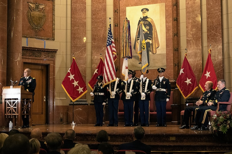 Gen. Gustave F. Perna, U.S. Army Materiel Command commanding general, left, delivers his remarks shortly after transferring command of the U.S. Army Financial Management Command from Maj. Gen. David C. Coburn, seated left, to Brig. Gen. Mark S. Bennett, far right, during a ceremony at the Indiana War Memorial in Indianapolis, Oct. 25, 2019. Coburn, the highest ranking service member stationed in Indiana, retired in a ceremony after the event, bringing his 37-year military career to a close. (U.S. Army photo by Mark R. W. Orders-Woempner)