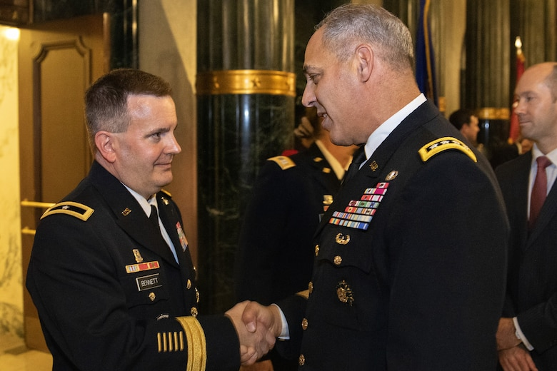 Gen. Gustave F. Perna, U.S. Army Materiel Command commanding general, right, congratulates Brig. Gen. Mark S. Bennett shortly after Bennett took command of the U.S. Army Financial Management Command during a ceremony at the Indiana War Memorial in Indianapolis, Oct. 25, 2019. The change of command was the first formal event for USAMCOM since its move under AMC earlier in the month. (U.S. Army photo by Mark R. W. Orders-Woempner)