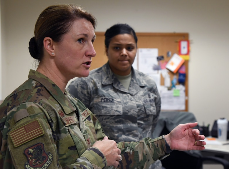 """U.S. Air Force Col. Beatrice Dolihite, 81st Medical Group commander, discusses the Base Operation Medicine Cell administration procedures with staff members inside the Keesler Medical Center at Keesler Air Force Base, Mississippi, Aug. 22, 2019. The """"Dragon Medic Experience"""" allowed the 81st MDG leadership to work side-by-side with group medics in order to understand the challenges and barriers they may face while providing care. It also allowed them to see first-hand the great ideas that the staff has implemented to focus on the patient experience. This experience helps us cultivate an environment where senior leadership has direct engagement and connection with our front line medics who strive to deliver outstanding care. (U.S. Air Force photo by Kemberly Groue)"""