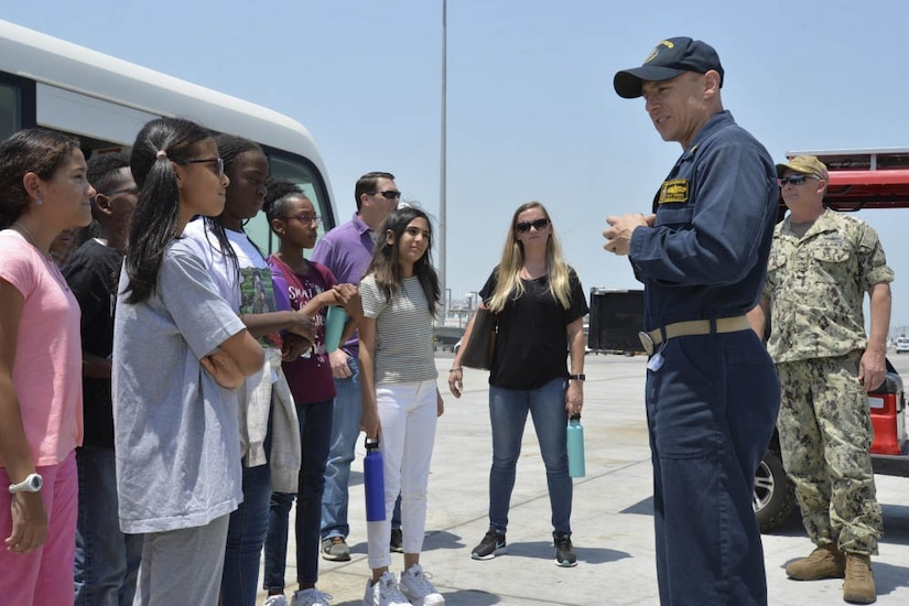 Navy ship commanding officer speaks to students.