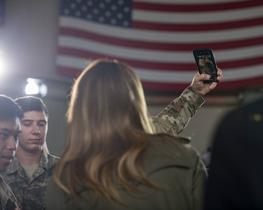 First Lady Melania Trump takes a selfie with a member of Team Charleston during her visit to Joint Base Charleston, S.C. October 30, 2019. While here, she met with Airmen, Sailors, Soldiers, Marines, Coast Guardsmen, and students from Lambs Elementary School to learn more about the community's capabilities in disaster response, relief and recovery efforts.