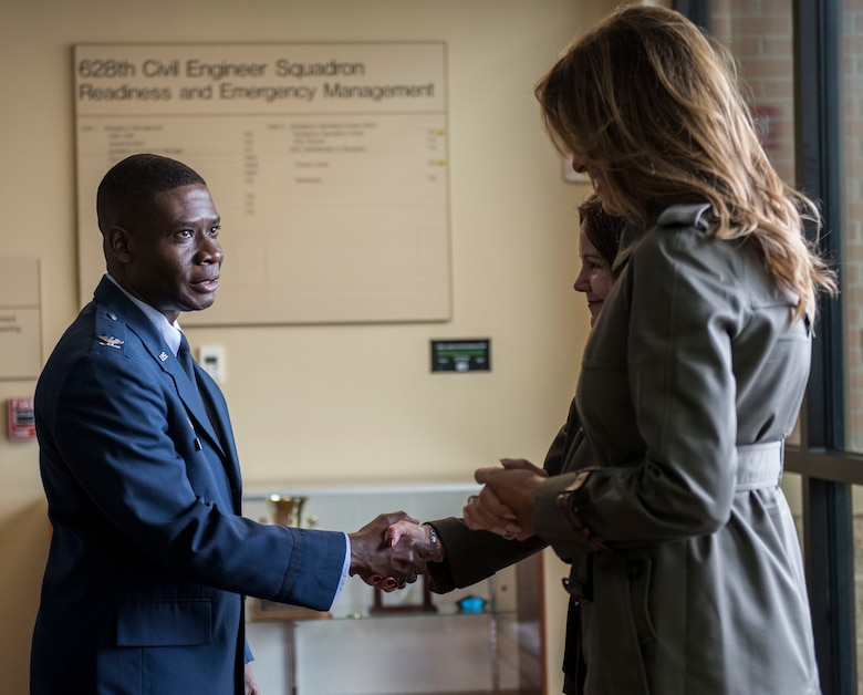 Col. Terrence Adams, Joint Base Charleston and 628th Air Base Wing commander, greets First Lady Melania Trump and Second Lady Karen Pence during a visit to JB Charleston, S.C. October 30, 2019. While here, they met with Airmen, Sailors, Soldiers, Marines, Coast Guardsmen and students from Lambs Elementary School to learn more about the community's capabilities in disaster response, relief and recovery efforts.
