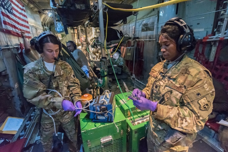 U.S. Air Force Lt. Col. Deveril Wint (right) medical crew director, and Capt. Elise Cunningham, a flight nurse, both assigned to the 379th Expeditionary Aeromedical Evacuation Squadron, Al Udeid Air Base, Qatar, pack up equipment following a theater patient movement mission from Afghanistan, Nov. 25, 2017. The EAES' mission is to transport wounded warriors from a lower level of medical treatment to a higher echelon of healthcare. (U.S. Air National Guard photo by Master Sgt. Phil Speck)