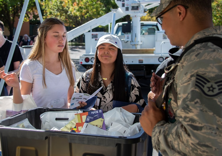 U.S. Air Force Staff Sgt. Luis Valencia, 60th Civil Engineer Squadron fire inspector, at Travis Air Force Base, California, discusses the firefighter mission to students attending the Inspire: Dreams Start Now exhibit, Oct. 22, 2019, at Ulatis Community Center, Vacaville, California.