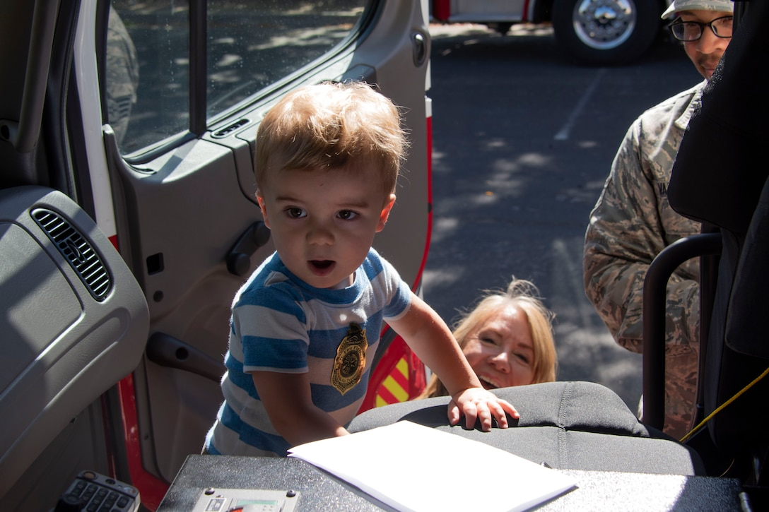 Lincoln McFadden, a toddler attending the Inspire: Dreams Start Now exhibit, stands inside a fire truck assigned to the 60th Civil Engineering Squadron, Oct. 22, 2019, at Ulatis Community Center, Vacaville, California.