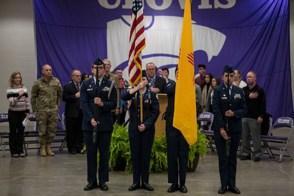 Members of the Clovis High School Junior Reserve Officers' Training Corps stand during the national anthem at the National Math and Science Initiative program reveal at Clovis, N.M., Oct. 30, 2019. The program is a two-year College Readiness program, developed and implemented by NMSI. (U.S. Air Force photo by Senior Airman Vernon R. Walter)