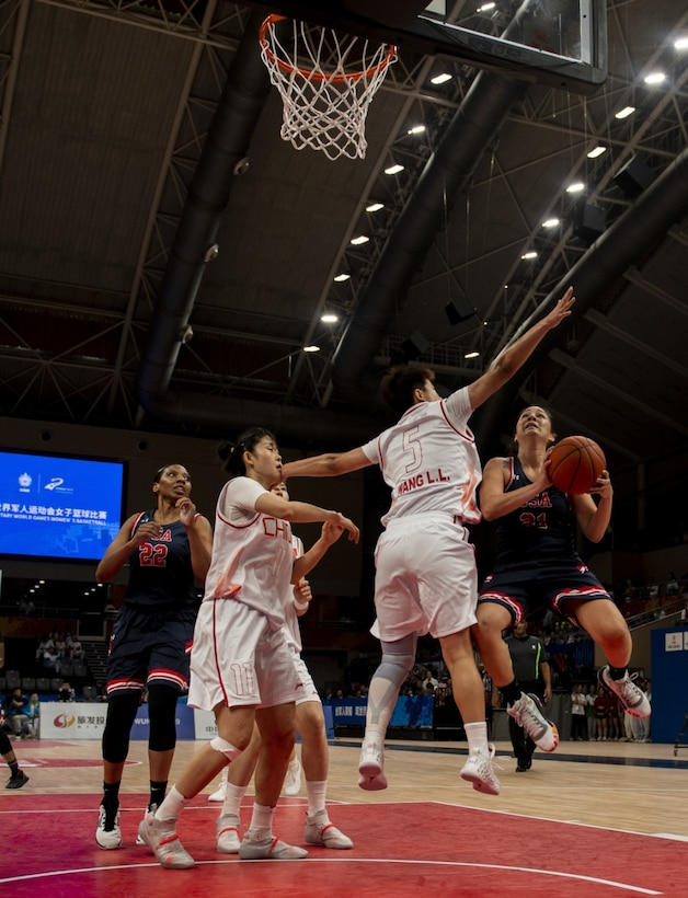U.S. Air Force Reserve Citizen Airman Senior Airman Santia Jackson, United States Armed Forces Military World Games Women's Basketball player, positions herself for a rebound as teammate Staff Sgt. Cinnamon Kava, drives past a Chinese defender for a layup during the Conseil International du Sport Militaire Women's Basketball Competition in Wuhan China, Oct. 22, 2019. The 7th MWG will feature military athletes from around the world with an estimated participation of more than 100 nations and more than 10,000 participants. (U.S. Air Force photo by Staff Sergeant James R. Crow)