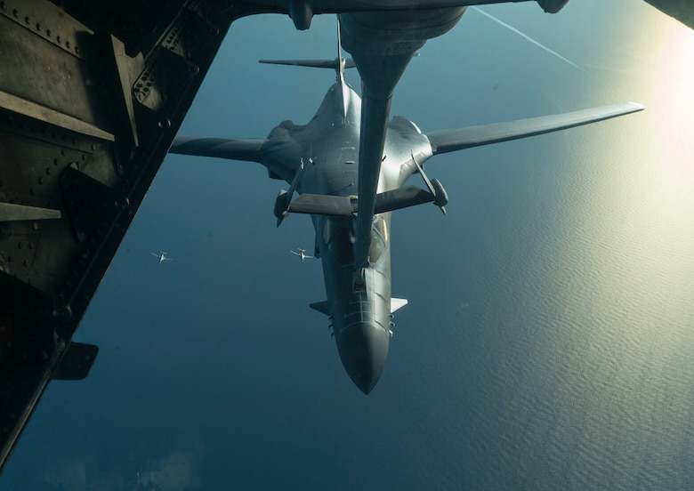 B-1B Lancers receive fuel from a KC-10 Extender