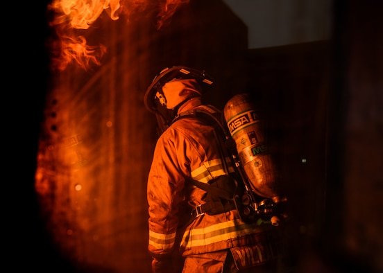 U.S. Senior Airman Jose Villalobos, 31st Civil Engineer Squadron fire protection journeyman, participates in a live fire training exercise at Aviano Air Base, Italy, Oct. 29, 2019. Live fire training is conducted in a burn building, which is a structure built to be intentionally burned for firefighter training. (U.S. Air Force photo by Airman Thomas S. Keisler IV)