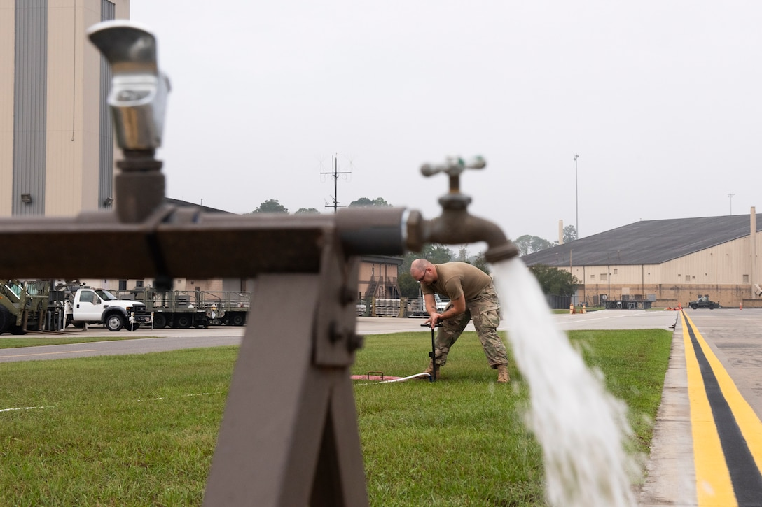 Staff Sgt. Douglas Shaw, 23d Civil Engineer Squadron (CES) water and fuel systems maintenance journeyman, tests water flow from a water pump Oct. 29, 2019, at Moody Air Force Base, Ga. The 23d CES installed water fountains around the flightline in preparation for the air show. This will give air show attendees locations for clean water and help with dehydration related injuries. (U.S. Air Force photo by Airman Elijah Dority)