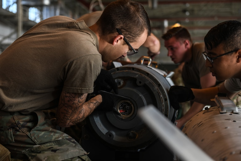 U.S Airmen from the 31st Munition Squadron conduct an inert bomb build at Aviano Air Base, Italy, Oct. 31, 2019. The Rapid Aircraft Generation and Employment competition highlighted several adaptive basing procedures. (U.S. Air Force photo by Airman 1st Class Ericka A. Woolever).