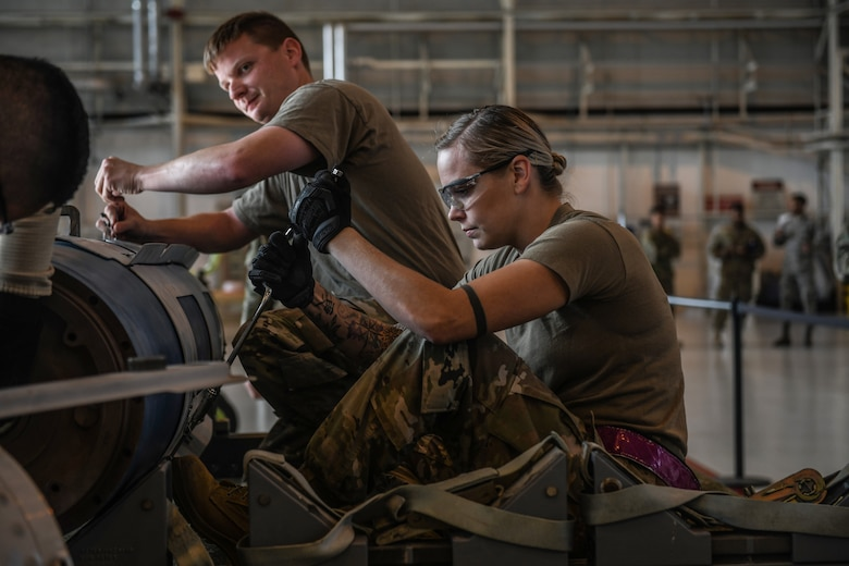 U.S Airmen from the 31st Munition Squadron conduct an inert bomb build at Aviano Air Base, Italy, Oct. 31, 2019. The Rapid Aircraft Generation and Employment competition is the first of its kind and will be held quarterly at Aviano AB. (U.S. Air Force photo by Airman 1st Class Ericka A. Woolever).
