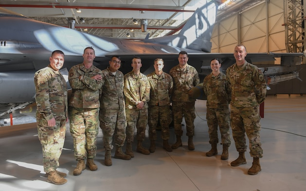"U.S Airmen from the 31st Munition Squadron and leadership pose for a photo at Aviano Air Base, Italy, Oct. 31, 2019. The ""Wing it"" team from the Rapid Aircraft Generation and Employment competition had a higher overall score and will have their names etched on plaques, which will be added to the 31st MUNS heritage. (U.S. Air Force photo by Airman 1st Class Ericka A. Woolever)."