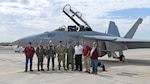 DCMA team standing in front of a F/A-18 Super Hornet.