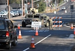 U.S. Army Spc. Maria Medina, a California Army National Guard soldier with Pittsburg-based 870th Military Police Company, blocks traffic from entering Healdsburg, California, Oct. 28, 2019, after an evacuation order was given to multiple towns near the Kincade Fire in Sonoma County.