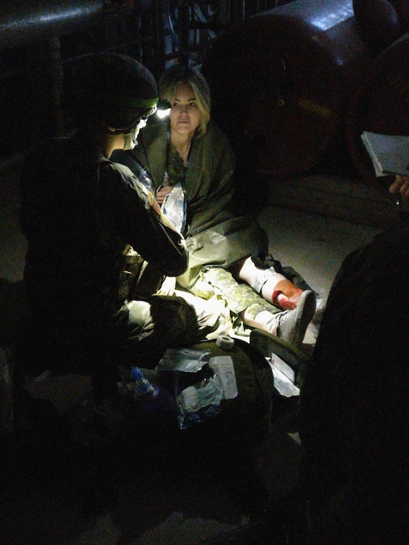 Pfc. Carleigh Landers provides care to a patient the St Luke's Field Ambulance Validation Event, hosted by the Canadian Armed Forces, 25 Field Ambulance, in Toronto, Ontario, Oct. 26th.