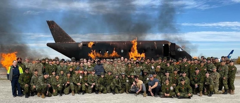 Competitors with the US Army Reserve and Canadian Armed Forces pose for a group photo at the St Luke's Field Ambulance Validation Event, hosted by the Canadian Armed Forces, 25 Field Ambulance, in Toronto, Ontario, Oct. 26th.