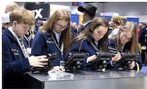 Members of Future Farmers of America use EMM Connect to register at the Army Interactive zone during this year's annual FFA convention in Indianapolis, Indiana Oct. 30.