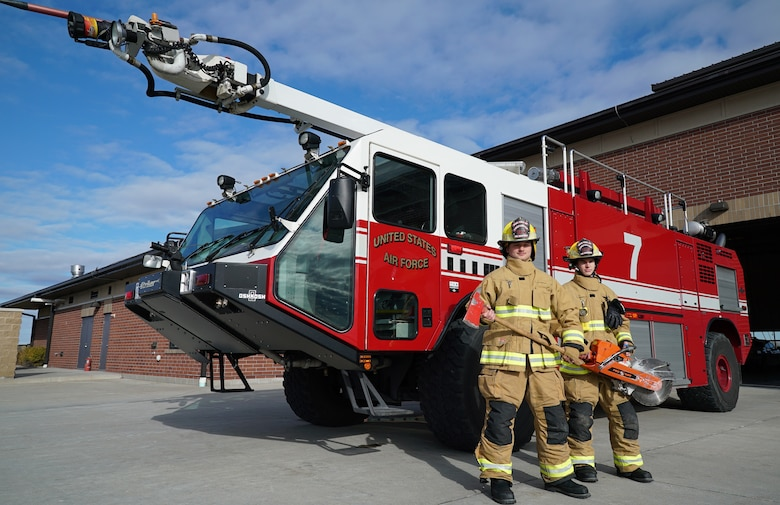 Firefighters with the 319th Civil Engineer Squadron, Airman 1st Class Hunter Garibay, left, and Airman 1st Class Sydney King, pose for a photo on National First Responders Day, Oct. 28, 2019, on Grand Forks Air Force Base, North Dakota. Garibay and King, new firefighters in the Air Force, expressed their drive to learn more and prepare themselves as potential heroes in a crisis situation. (U.S. Air Force photo by Senior Airman Elora J. Martinez)