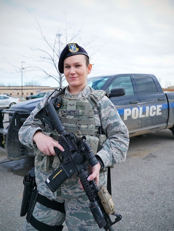 Airman 1st Class Taylor Lingscheit, 319th Security Forces Squadron installation entry controller, poses for a photo on National First Responders Day, Oct. 28, 2019, on Grand Forks Air Force Base, North Dakota. Lingscheit said she feels rewarded, knowing her line of duty puts her in a position to defend the base. (U.S. Air Force photo by Senior Airman Elora J. Martinez)