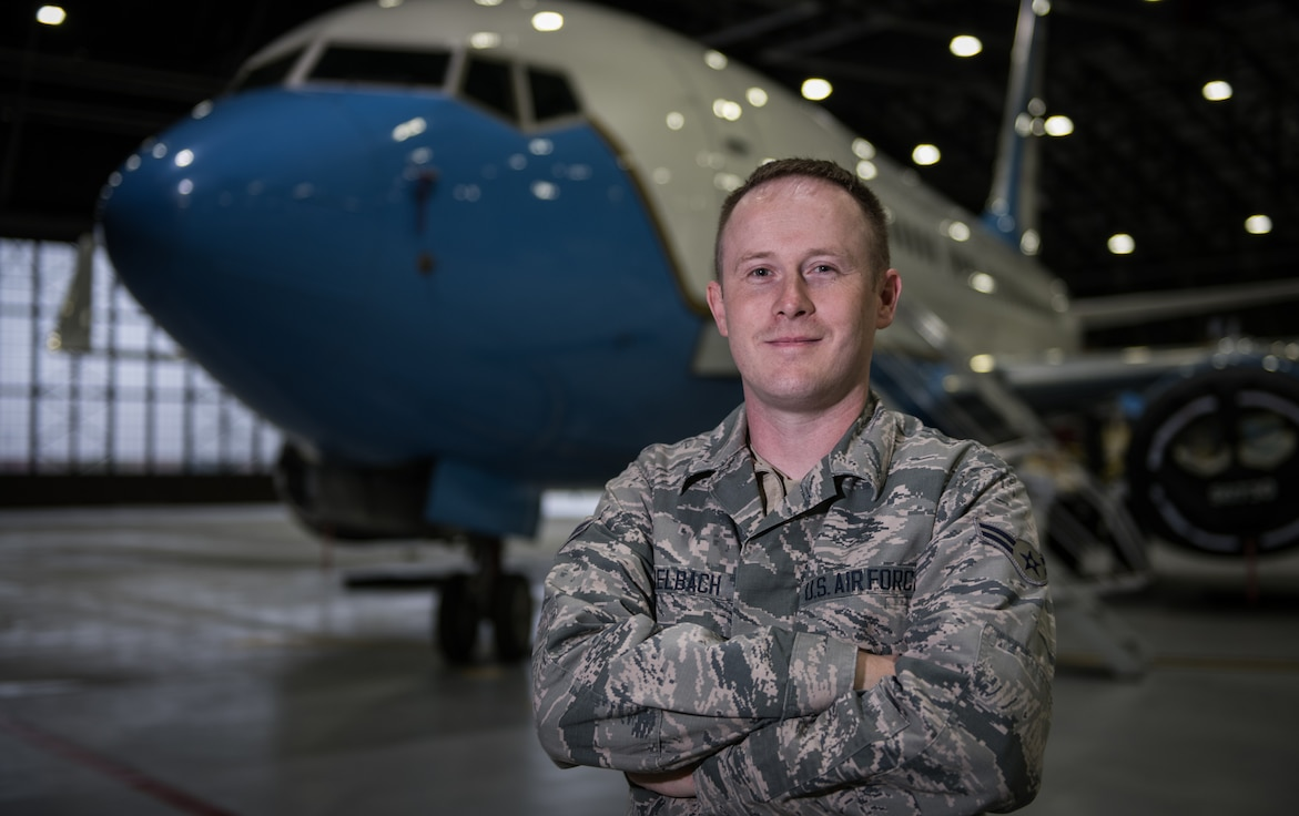 Airman 1st. Class Jeremy Zirkelbach, a 932nd Maintenance Squadron crew chief, poses with a C-40 as a backdrop, Oct. 30, 2019 inside Hangar 1, Scott Air Force Base, Illinois. Zirkelbach was selected by his leadership as the Airman Spotlight for October.  Each month an Airman shares their Air Force story with Wing leadership during the Wing review briefing. (U.S. Air Force photo by Christopher Parr)