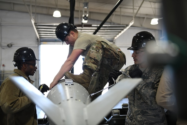 Airmen from the 28th Munitions Squadron separate a Joint Direct Attack Munition (JDAM) from its tail kit during a U.S. Strategic Command exercise on Ellsworth Air Force Base, S.D., Oct. 21, 2019. Global Thunder is an annual command and control exercise that provides training opportunities for all of U.S. Strategic Command's mission areas, tests joint and field training operations, and has a specific focus on nuclear readiness. (U.S. Air Force photo by Airman 1st Class Christina Bennett)