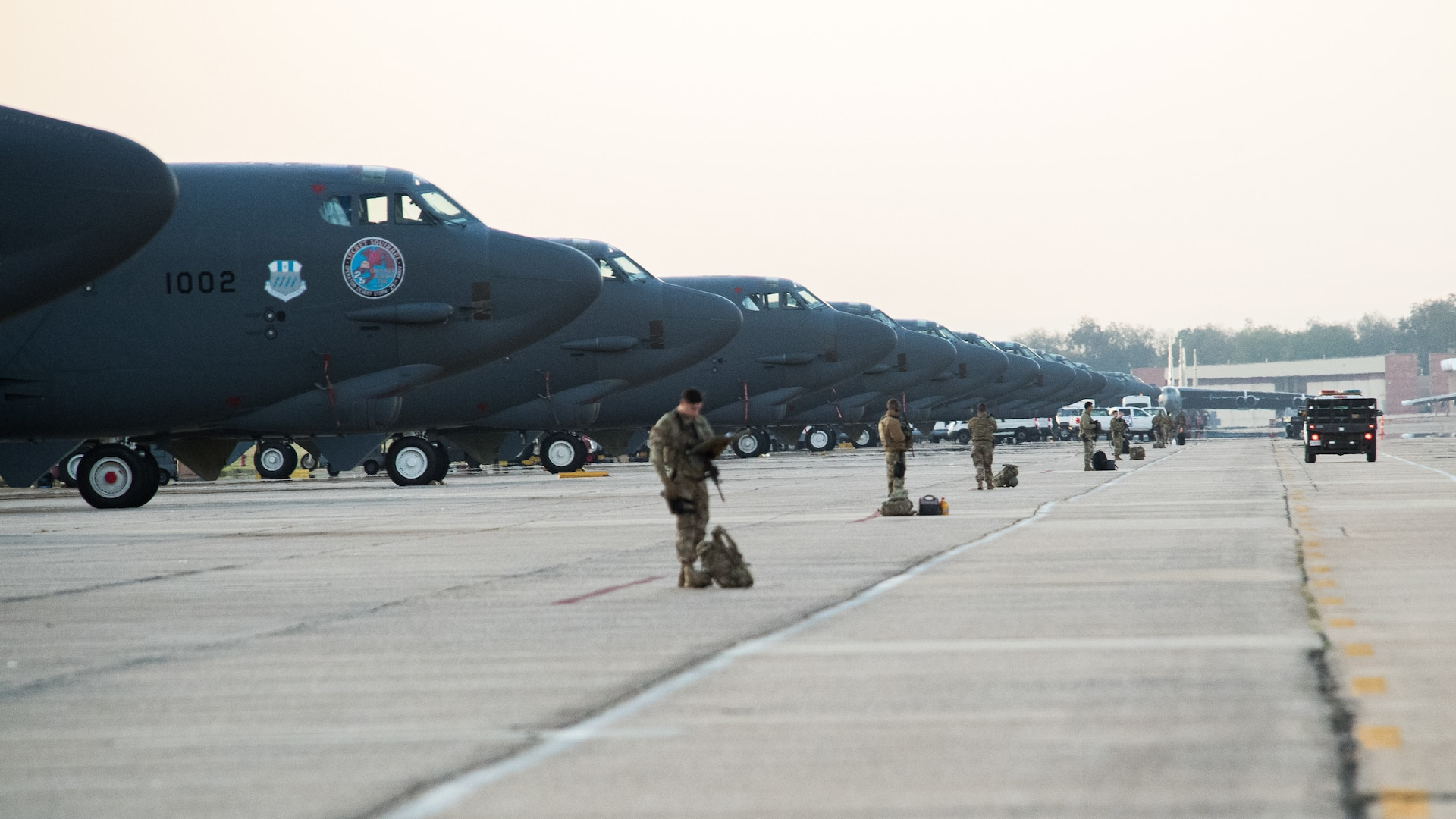 Airmen assigned to the 2nd Security Forces Squadron stand guard in front of B-52H Stratofortress aircraft in support of Global Thunder 20 at Barksdale Air Force Base, La., Oct. 22, 2019. Global Thunder is an exercise that focuses on U.S. Strategic Command and component forces' ability to support the geographic combatant commands, deter adversaries and, if necessary, employ forces as directed by the President of the United States. (U.S. Air Force photo by Senior Airman Tessa B. Corrick)