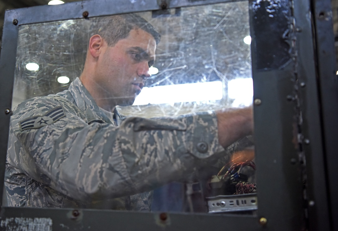 Senior Airman John Vega-Guzman, 100th Maintenance Squadron aerospace ground equipment technician, repairs wiring on a ground power unit at RAF Mildenhall, England, Oct. 23, 2019. The AGE shop inspects hundreds of pieces of equipment which are essential to ensuring an aircraft's mission readiness. (U.S. Air Force photo by Senior Airman Brandon Esau)