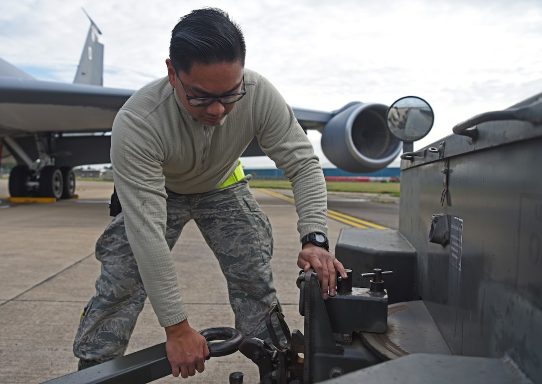 Airman 1st Class Marcus Macalinao, 100th Maintenance Squadron aerospace ground equipment technician, detaches a ground power unit at RAF Mildenhall, England, Oct. 23, 2019. AGE technicians support the Air Force mission with their expertise of maintaining, fixing and troubleshooting flightline equipment at Air Force bases worldwide. (U.S. Air Force photo by Senior Airman Brandon Esau)