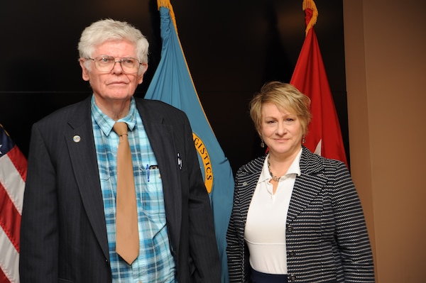 James McCloskey, left, and Stephanie Fuss, both of the Defense Logistics Agency Troop Support's Procurement Process Support office, retired this week after 54 and 40 years of federal service, respectively. They were celebrated during a civilian retirement ceremony held Oct. 30, 2019 at DLA Troop Support Headquarters in Philadelphia. (Photo by Edward Maldonado)