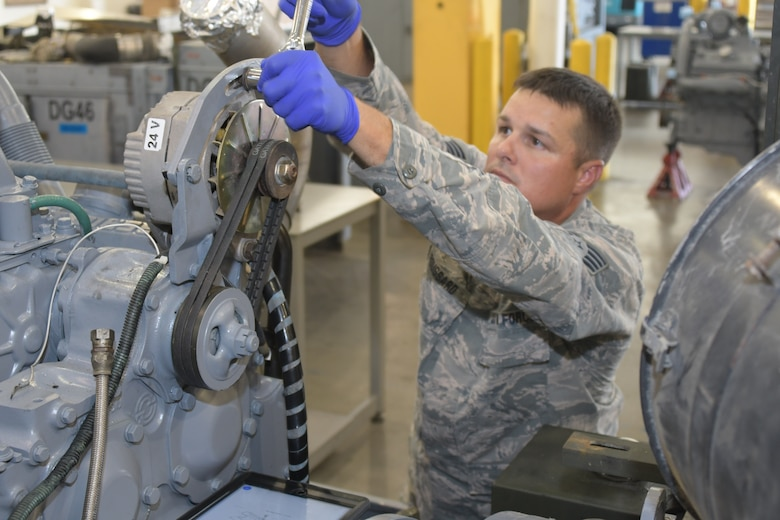 U.S. Air Force Staff Sgt. Justin Broussard, 116th Maintenance Group, 116th Air Control Wing, Georgia Air National Guard, works on aerospace ground equipment at Robins Air Force Base, Georgia, Oct. 1, 2019. Broussard will be representing Team USA in golf at the 7th CISM World Games in Wuhan, China. U.S. Air National Guard photo by Barry Bena.