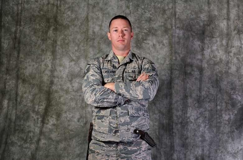 Master Sgt. Casey Cleveland, 507th Aircraft Maintenance Squadron maintenance supervisor, poses with his handmade blades Oct. 22, 2019, at Tinker Air Force Base, Oklahoma. Cleveland recently competed on the bladesmithing competition show Forged in Fire on the History Channel. (U.S. Air Force Photo by Senior Airman Mary Begy)