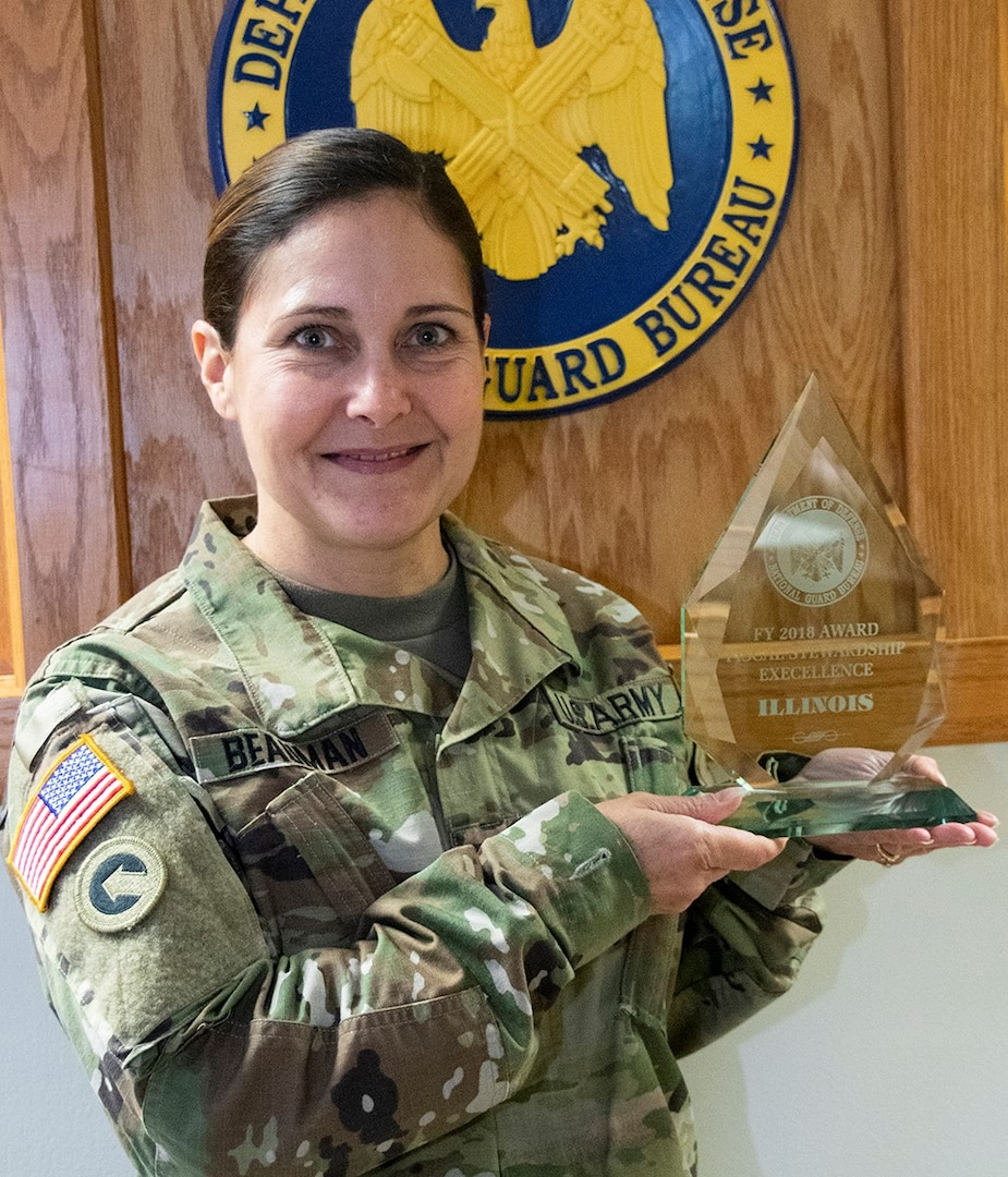 Col. Melissa Beauman, Illinois National Guard's United States Property and Fiscal Office, with the Fiscal Stewardship Award presented to the Illinois National Guard by the National Guard Bureau's Directorate of Programs and Resources, during the annual USPFO workshop. This is the second consecutive year the Illinois National Guard has earned the Fiscal Stewardship Award, an award noting USPFO's work to be excellent stewards of taxpayer dollars. (U.S. Army photo by Barbara Wilson, Illinois National Guard Public Affairs Office)
