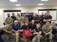 Members of the District of Columbia National Guard's 33rd Civil Support Team take time to celebrate the National's victory over the Houston Astros. In addition to supporting the Marine Corps Marathon, the 33rd CST provided District officials support during the historic 2019 Major League Baseball World Series games at the National's Stadium Oct. 25-27.