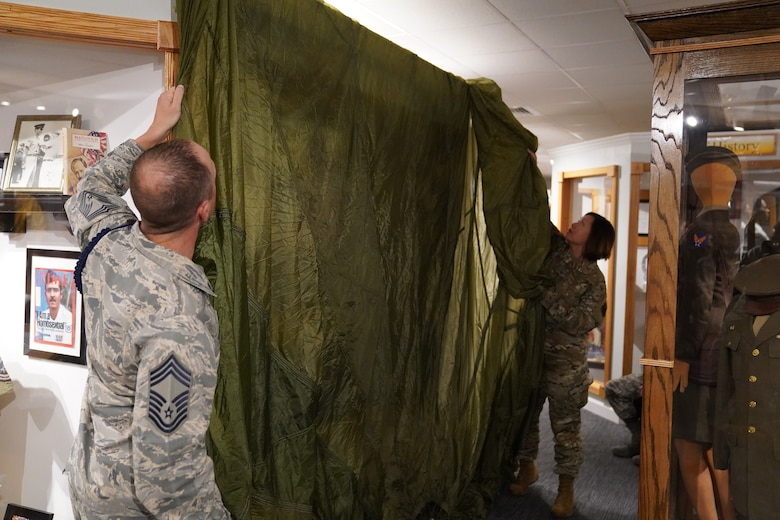 U.S Air Force Chief Master Sgt. Daniel Reed, Second Air Force military training instructor and military training leader career field manager, and Chief Master Sgt. JoAnne Bass, Second Air Force command chief, prepare to unveil the MTL wall at Maxwell Air Force Base Gunter Annex, Alabama, Oct. 30, 2019. MTLs play a vital role in the development of the next generation of Air Force leaders, warfighters, and protectors of freedom. The Air Force Enlisted Heritage Hall has dedicated a wall to highlight their lineage and contributions to the Air Force. (U.S Air Force photo by Airman 1st Class Spencer Tobler)