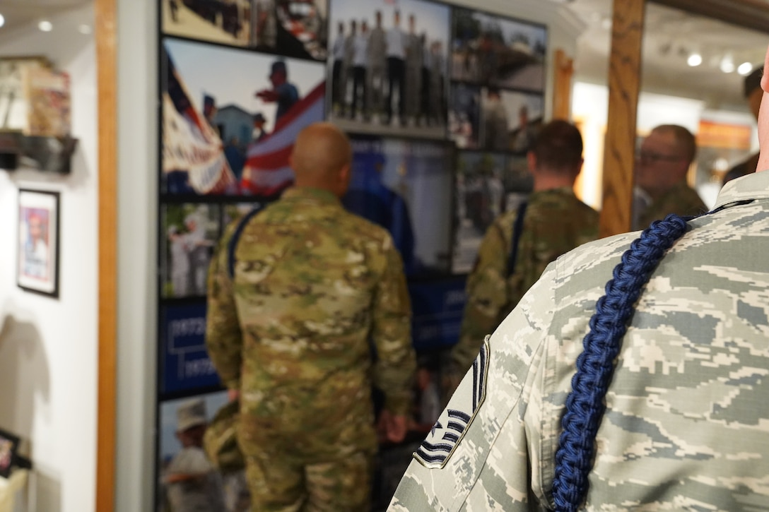U.S Air Force Senior Master Sgt. Sean Brasier, Second Air Force command military training leader, reviews the brand-new MTL wall at the Air Force Enlisted Heritage Hall at Maxwell Air Force Base Gunter Annex, Alabama, Oct. 30, 2019. MTLs play a vital role in the development of the next generation of Air Force leaders, warfighters, and protectors of freedom. The Air Force Enlisted Heritage Hall has dedicated a wall to highlight their lineage and contributions to the Air Force. (U.S Air Force photo by Airman 1st Class Spencer Tobler)