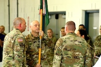 233rd Military Police Company 1st Sgt. Jeramie Mayes passes the company guidon during a change of responsibility during his retirement ceremony at Camp Lincoln, Springfield, Illinois. Mayes is retiring from the Illinois Army National Guard after a 31 year career.