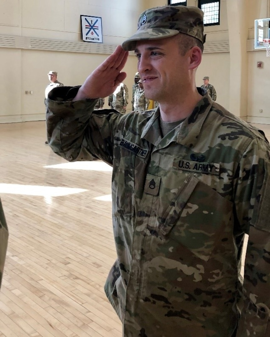 Staff Sgt. Gregory Baumgartner of Elmwood, Illinois, salutes his commanding officer after a promotion ceremony at the Urbana Readiness Center in Urbana Oct. 18.