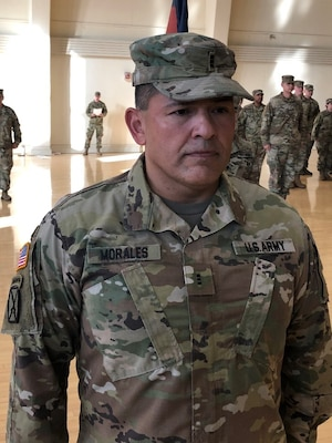 Chief Warrant Officer-3 Juan Morales of Joliet, Illinois, stands at the position of attention during his promotion ceremony at the Urbana Readiness Center in Urbana Oct. 18.