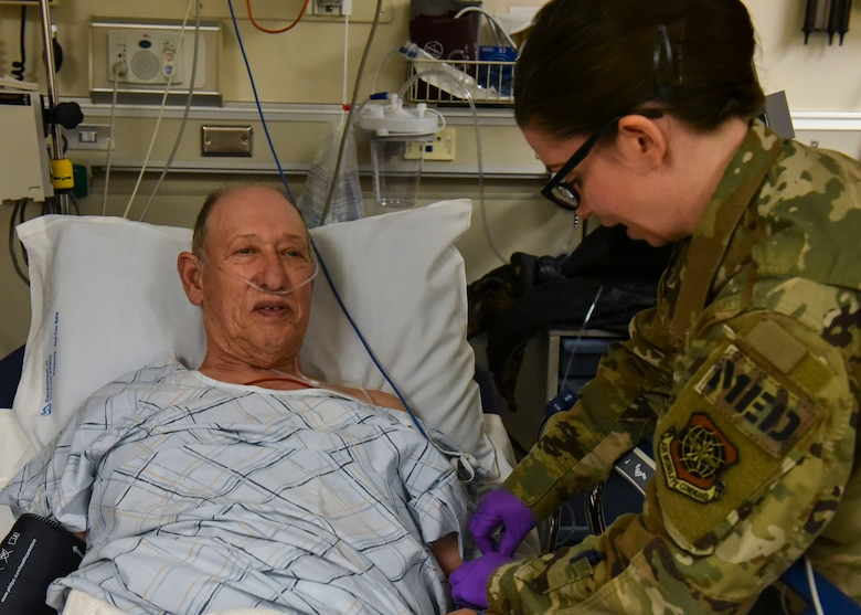 U.S. Air Force Master Sgt. Alaina Kolesnik, 92nd Health Care Operations Squadron beneficiary primary care flight chief, simulates preparing a patient's IV at the Mann-Grandstaff Veteran Affairs Medical Center in Spokane, Washington, Oct. 23, 2019.