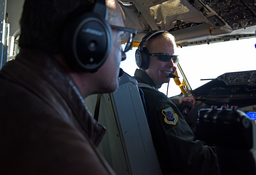 U.S. Air Force Col. Derek Salmi, 92nd Air Refueling Wing commander, talks to Jeff Vom Saal, Team Fairchild honorary commander, about in-flight operations during a civic leader tour to Scott Air Force Base, Illinois, Oct. 16.  The tour is designed to increase civic leaders' understanding of Air Mobility Command, United States Transportation Command, 618th Air Operations Command and how the community can impact Airmen's quality of life. (U.S. Air Force photo by Senior Airman Jesenia Landaverde)