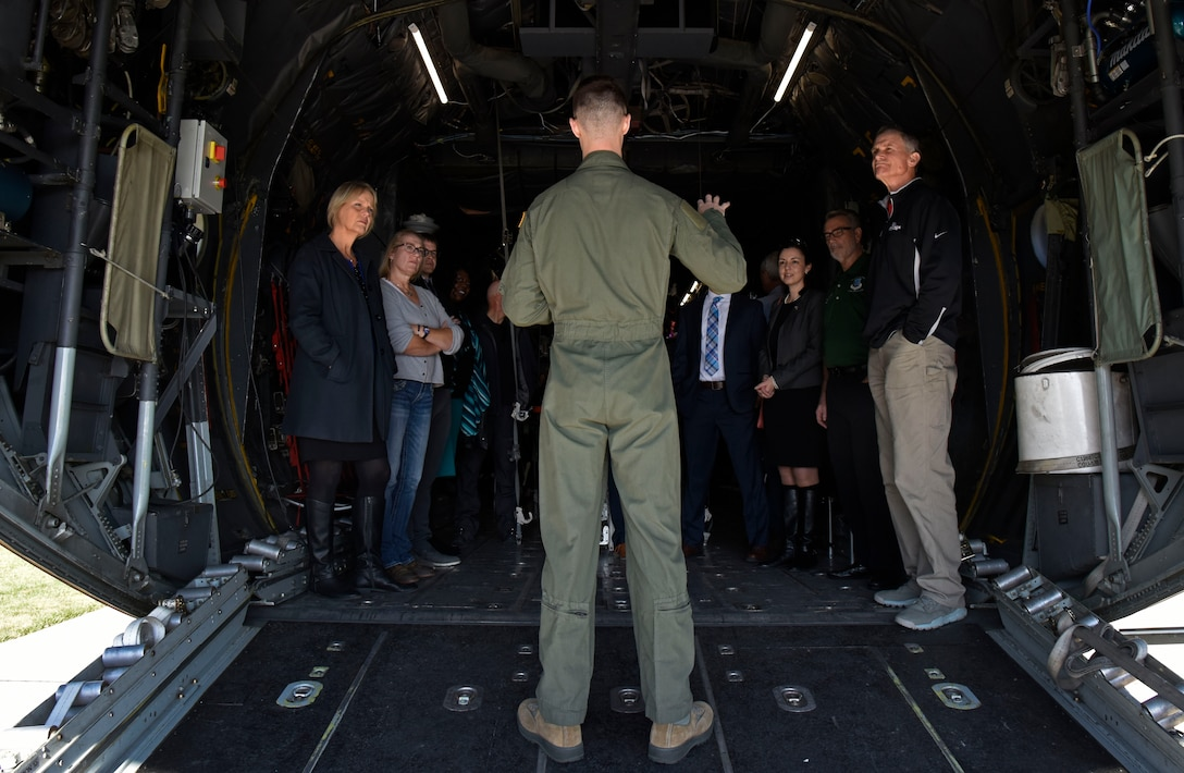 U.S. Air Force Staff Sgt. Brannon Tulloss, 375th Aeromedical Evacuation Squadron technician, briefs Spokane-area civic leaders on the roles and responsibilities of in-flight medical care during a civic leader tour to Scott Air Force Base, Illinois, Oct. 17. The squadron plays a key role in providing critical patient care for service members assigned to bases with limited medical resources. (U.S. Air Force photo by Senior Airman Jesenia Landaverde)