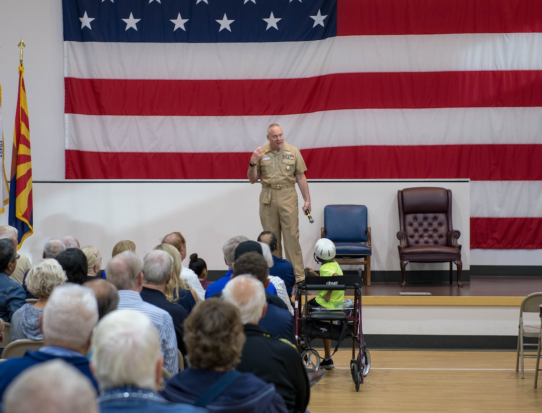 Retired Senior Chief Petty Officer Eric W. Wenzel, Secretary of the Navy Retiree council recorder, speaks at a Retiree Appreciation Day (RAD) event Oct. 26, 2019, at the Navy Operational Support Center at Luke Air Force Base, Ariz.