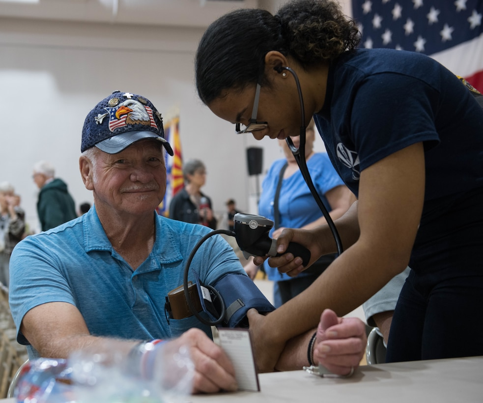 Airman 1st Class Sarah Amato, 56th Operational Medical Readiness Squadron operational medical technician, measures a retiree's blood pressure during a Retiree Appreciation Day (RAD) event Oct. 26, 2019, at the Navy Operational Support Center in Luke Air Force Base, Ariz.