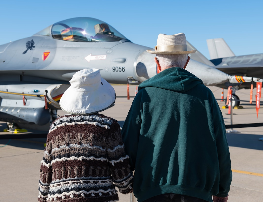 Two military retirees admire an F-16C Fighting Falcon during a Retiree Appreciation Day event Oct. 26, 2019, at Luke Air Force Base, Ariz.